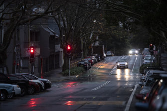 Quiet Sydney streets on a wet, chilly Friday night.