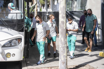 The Australian team emerge from quarantine in Homebush on Thursday.