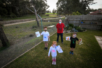 Lilydale resident Ian Fairweather and his grandchildren, Heidi, 4, Sammy 7 and Jack 11 in his backyard on Thursday.