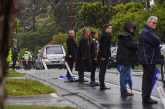 Mourners formed guard of honour in the rain after the funeral for Constable Glen Humphris on Friday.