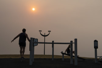 An early morning workout in the haze at Maroubra Beach in November.