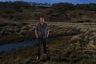 Indigenous Snowy Mountains guide Richard Swain has faced racist abuse and harassment for his stance on feral horses. Swain is pictured on Long Plain where he says trampling by horses has damaged the creeks and threatened the habitat of the native Broad-Tooth Rat.