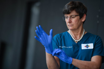 Professor Diana Egerton-Warburton with some protective gloves.