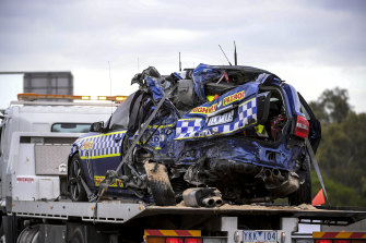One of the police cars being removed from the scene of the Eastern Freeway crash.