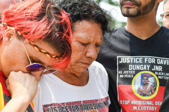 David Dungay's cousin Lizzie Jarrett, mother Leetona Dungay and nephew Paul Silva outside the Lidcombe Coroner's Court in Sydney, in November 2019.