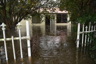 A flooded home in Pitt Town, in Sydney's west. The weather bureau warns parts of Victoria should expect heavy rain and damaging winds.