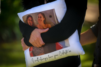 Celeste Manno's mother, Aggie Di Mauro, clutches a pillow with a photo of her daughter.
