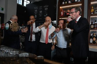 NSW Premier Dominic Perrottet enjoys a beer on Monday with Deputy Premier Paul Toole and Treasurer Matt Kean at Watson's Pub in Moore Park.
