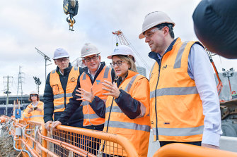 Victorian Premier Daniel Andrews (centre), Transport Infrastructure Minister Jacinta Allan (right) and Rail Projects Victoria head Evan Tattersal at the North Melbourne Metro tunnel site.