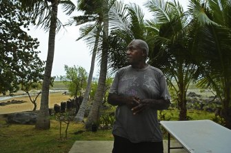 Stanley Cook in his garden on the shoreline on Thursday Island.