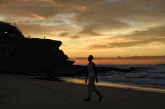 COMMAS showed its range, including its first women's designs, at sunrise at Sydney's Tamarama Beach.