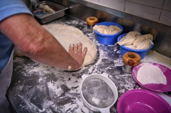 No knead: CWA Volunteers bake scones at the Sydney Royal Easter Show on Thursday.