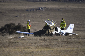 Fire and Rescue personnel near the wreckage of a light plane which crashed near Braidwood on Tuesday, killing the pilot.