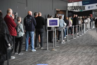 People queueing outside the Melbourne Convention and Exhibition Centre on Monday, one of Victoria's mass vaccination hubs, to get the AstraZeneca vaccine.