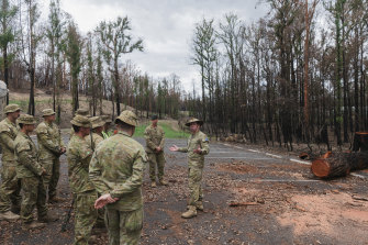 Colonel Warwick Young addresses ADF troops working at the Botanic Gardens in Mogo.