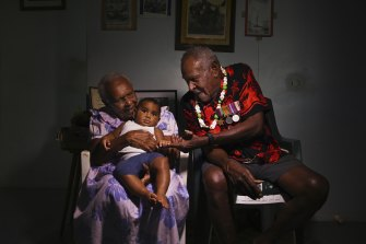 Warusam with his wife Rona, 93, and great-grandchild Masterson Waia aged 5 months old at their home on Saibai Island.