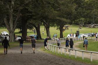 Runners and walkers in Centennial Park last week.