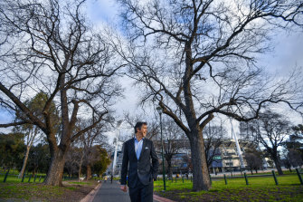 Melbourne City Councillor Nick Reece at the MCG with some of the 130-year-old elms set to be added to the city's Exceptional Tree Register.
