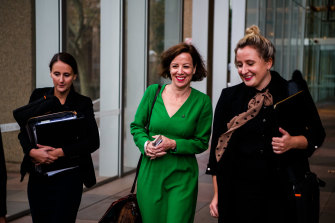 Jo Dyer, centre, outside court on Tuesday.