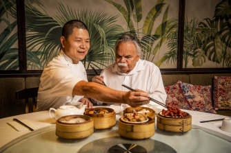 Chinese migrant Stevenson Su and Aboriginal elder Steve Widders share lunch at Mr Su's restaurant in Canley Vale. Both took part in the National Australia Day Council's new campaign.