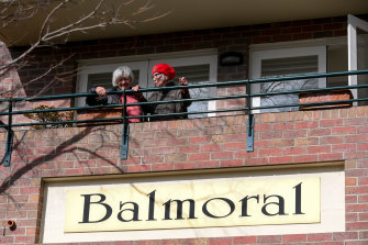 Residents of the Balmoral Apartment complex in Hawthorn on Friday.