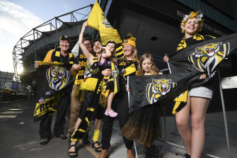 Tigers fans outside the Gabba, which will host the AFL grand final this year. Left to right: Paul Jones, Reeve McLennan, Rebecca Keys, Suzie Rowe and daughters Alice, 8, and Sarah 3, and Ryley Linnell.
