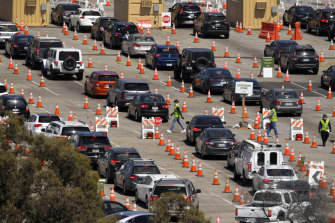 Cars queue at a drive-through coronavirus testing site at Dodger Stadium in Los Angeles last month.
