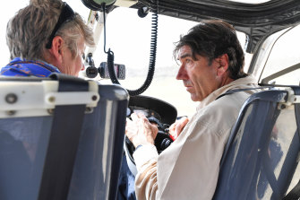 Helicopter pilot Col de Pagter (right) and Acacia Rose before takeoff to inspect Kosciuszko National Park in November.