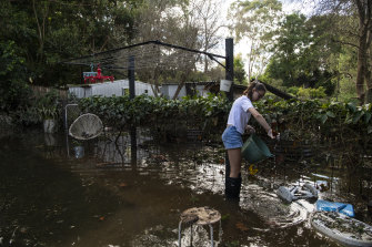 Ruby Bugeja, 13, helping clean her flooded home.