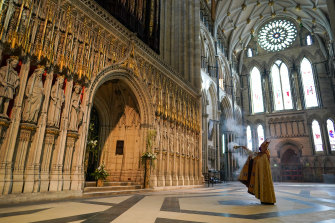 The Archbishop of York, Stephen Cottrell performs a blessing of York Minster's Great Organ during the Easter Sunday Evensong service at the cathedral in York, England.