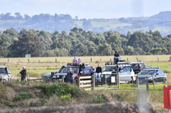 Onlookers lined the Princes HIghway to watch the eight chimneys on the former Hazelwood Power Station be demolished.