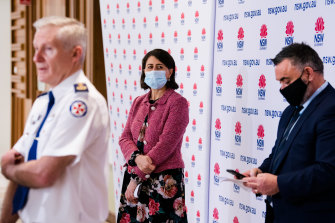NSW Premier Gladys Berejiklian at Firday's COVID-19 update, with NSW Ambulance Commissioner Dominic Morgan (left) and Deputy Premier John Barilaro (right).