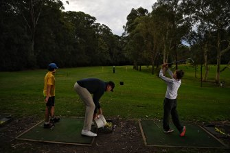 Young golfers at a coaching clinic ran by Brad Fasher at Lane Cove Country Club, which will be affected by a proposed new sporting complex.