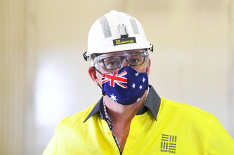 Prime Minister Scott Morrison wears a hard hat and face mask during a visit to South32′s Cannington coal mine in McKinlay, Queensland last week.