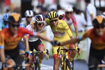 Tadej Pogacar celebrates winning the Tour de France.
