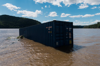 A shipping container washed up in the Hawkesbury River near Sydney during the March floods.