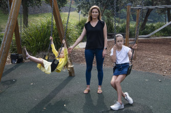 Shannon Ruddock with her daughters Abby and Maddie at the playground at  Bronte Beach.