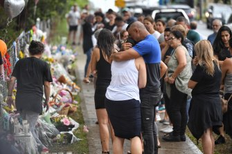Emotional scenes at the site of Saturday's crash, in which four children were killed.