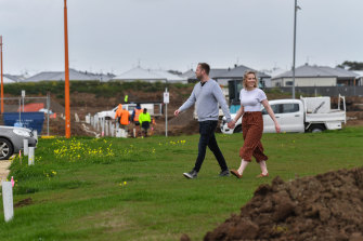 Amy Pullen and James Cowey inspecting the new estate where they will live.