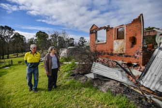 Lyn and Allan Wallwork in June beside their destroyed Sarsfied home, which has since been demolished.