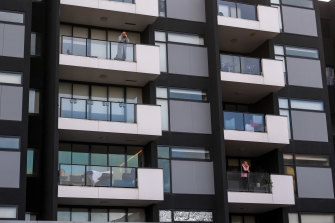Residents in their locked-down apartments on Tuesday.