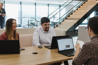 Anthony Kyle, who is on the autism spectrum, works for SAP in Sydney in the finance team. Mr Kyle (right) is with chief financial officer Gina McNamara and another team member.