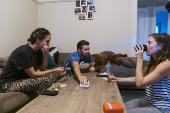 Flatmates Emily Logan, Chris Jackson and Brienna Anderson at home in Coogee.