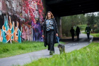 Anita Brown-Major walks her dog Molly.