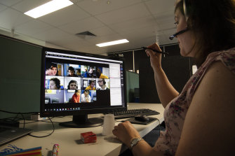 An Aurora College teacher gives a virtual class for kids in remote areas.