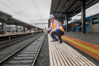 Stephen Webster of Integrated Recycling beside the recycled plastic sleepers his company supplied at Richmond station.