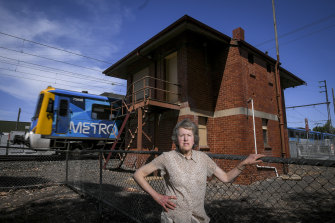 Marilyn Moore from Coburg's Historical Society in front of an old signal box set to be demolished to make way for sky rail.