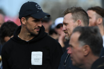 Collingwood captain Scott Pendlebury and coach Nathan Bluckey chat at half-time of the Pies v Hawks VFL match.