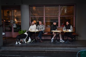 George and Peter Larsen (left) sat down for a coffee at Gilson in South Yarra after restrictions eased on Friday.