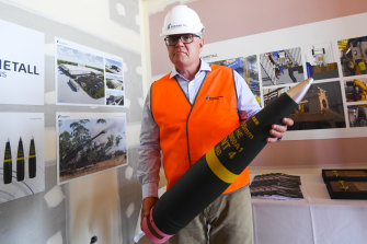 Lacking firepower? Australian Prime Minister Scott Morrison with a shell at an ammunition factory in Maryborough, Queensland, this month.